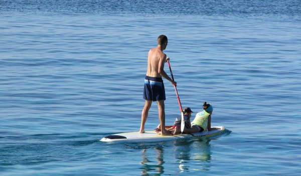 Did you know you can paddle surf when you hire a boat in Ibiza?